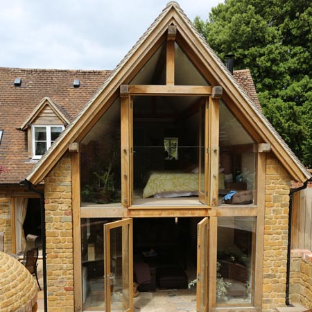 The design centre green oak extension to listed cottage for Cottage extension designs