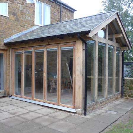 The design centre green oak frame garden room extension for Timber garden rooms
